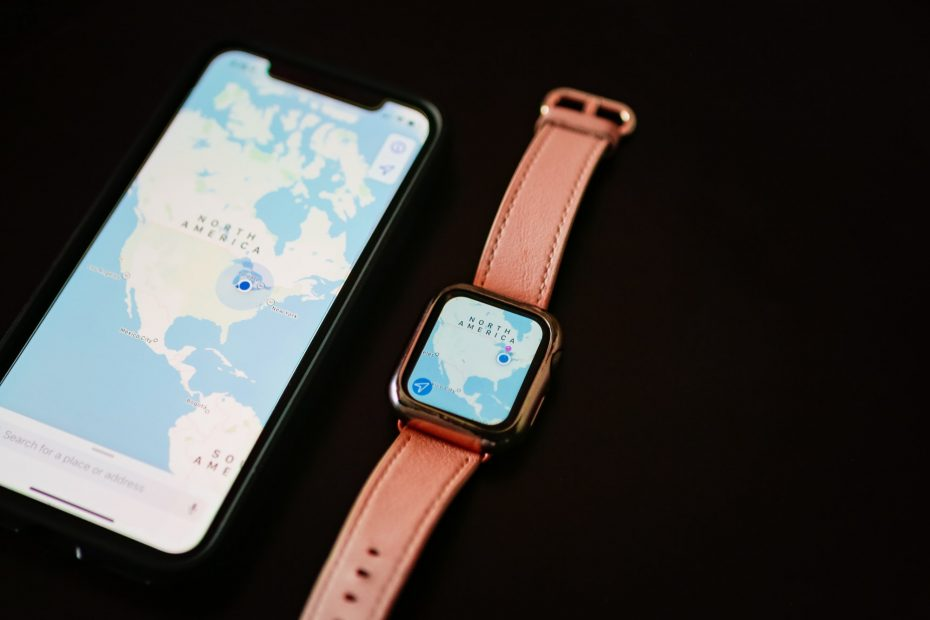 iPhone with map of North America next to Apple Watch with matching map on black background